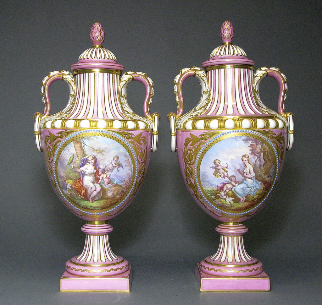 A PAIR OF SEVRES PINK GROUND JEWELED ENAMEL COVERED URNS Sevres Second half of 19th century