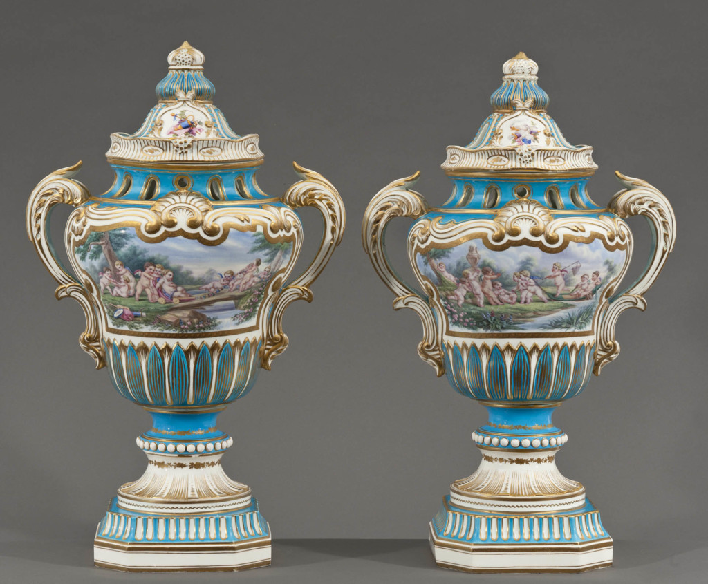 A PAIR OF SEVRES HAND PAINTED AND GILT-DECORATED URNS Sevres Early 19th Century
