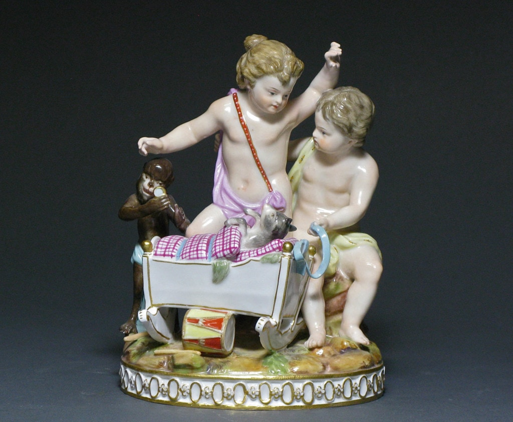 A group of two Putti 'Playing House' Meissen 19th Century
